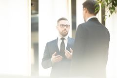 Conversation of businessmen Stock Images