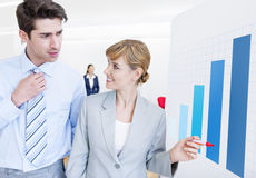 Two Young Business People Discussing Statistics Stock Images