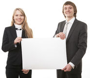 Two young business people show white sign Royalty Free Stock Image
