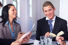 Two young business people sitting at table Royalty Free Stock Image