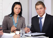 Two young business people sitting at table Royalty Free Stock Photo