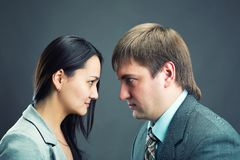 Two young business people talking and discussing royalty free stock images