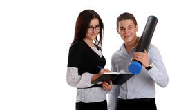 Two young business people working stock photos