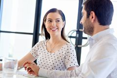 Image of two young business people in office Stock Photos