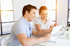 Image of two young business people in office Stock Images