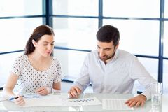 Image of two young business people in office Royalty Free Stock Photo