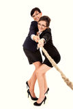 Two young business woman, pulling the rope Royalty Free Stock Photo