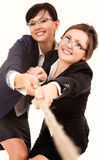 Two young business woman, pulling the rope Stock Photos