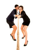 Two young business woman, pulling the rope Royalty Free Stock Photos