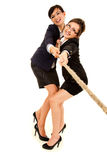 Two young business woman, pulling the rope Royalty Free Stock Image