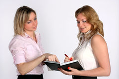 Two young business women Royalty Free Stock Photos
