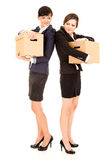 Two young business women with carton boxes, standing and smiling Stock Photography