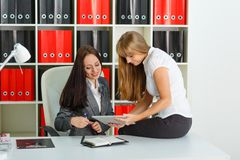 Two young business women. Royalty Free Stock Image