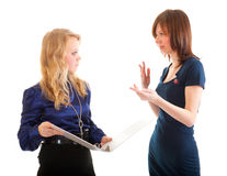 Two young business women discussing documents Stock Photos
