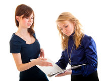 Two young business women discussing documents Royalty Free Stock Image