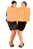 Two young business women holding the cork board Stock Photography