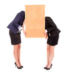 Two young business women holding the cork board Stock Photo