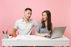 Two smiling business woman man colleagues sit work at white desk stock photos