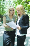Two Young Business Women in park Stock Image