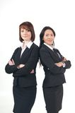 Two young business women standing together Stock Photo