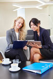 Two young business women with tablet computer Stock Photo