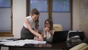 Two young business women working on a serious project. They tense situation, they are confused about the terms and stock video
