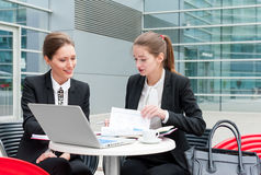Two young business women royalty free stock image