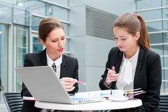 Two young business women Stock Photos