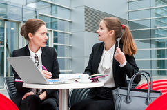 Two young business women Stock Image