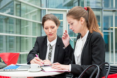Two young business women. Works together Stock Image