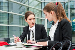 Two young business women Royalty Free Stock Images