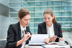 Two young business women Royalty Free Stock Photo