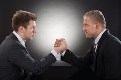 Two young businessman arm wrestling Royalty Free Stock Photo