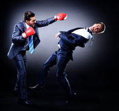 Two young businessman boxing Stock Image