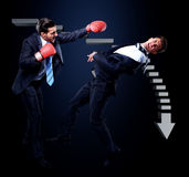 Two young businessman boxing a Royalty Free Stock Photo