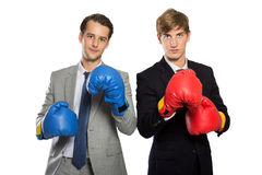 Two young businessman with boxing gloves, rivalry concept, isola Royalty Free Stock Photo