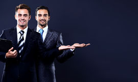 Two young businessman showing empty copyspace Royalty Free Stock Photo