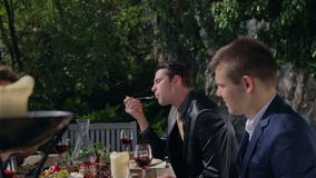 Two young businessman trays food stock footage