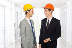 Two young businessman wearing safety helmet Stock Photography