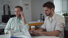 Two young businessman working at the modern office. stock footage