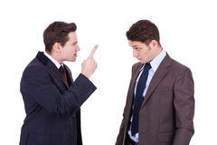 Two young businessmen arguing royalty free stock photo