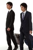 Two young businessmen on a business trip Royalty Free Stock Photo