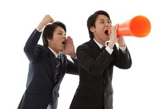 Two young businessmen are cheering coworkers Royalty Free Stock Images