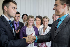 Two young businessmen congratulates each other Royalty Free Stock Photo