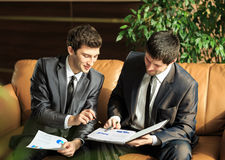 Two young businessmen discussing project Stock Photography