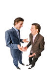 Two young businessmen discussing something Stock Images