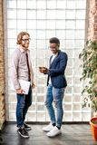 Two businessmen standing in the loft office royalty free stock photo