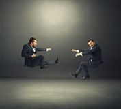 Two young businessmen in fight Royalty Free Stock Photos