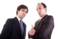 Two young businessmen giving consent, Stock Photography