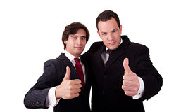 Two young businessmen giving consent, with thumb u Stock Photo